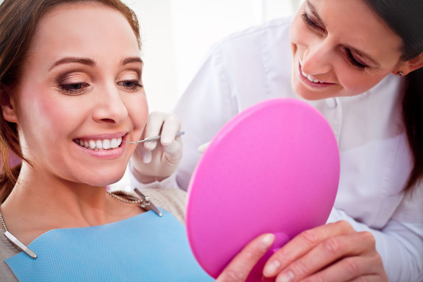 A dental hygenist talking with a patient after they have had their procedure done at our Westchester dental practice